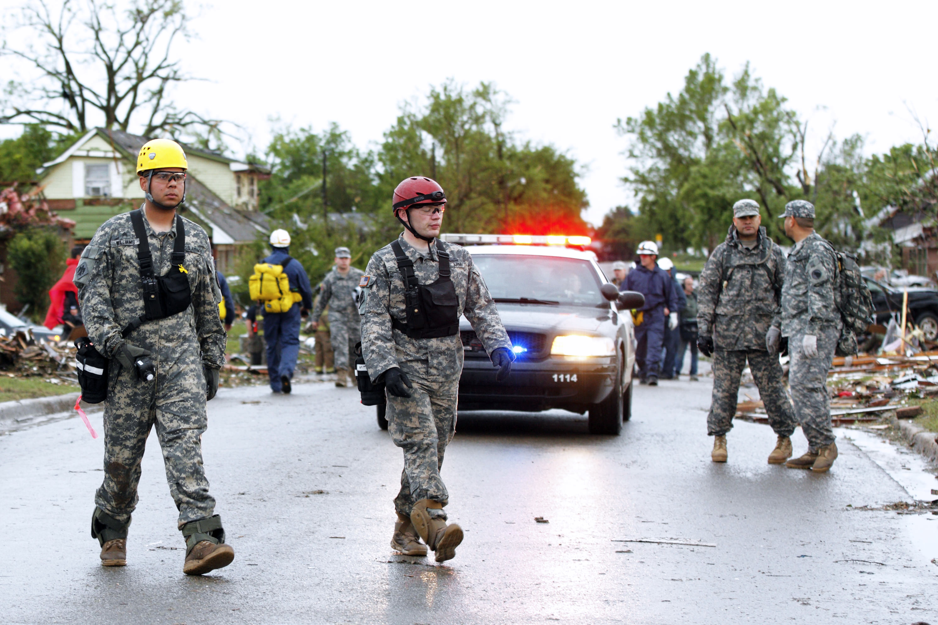 national guard in damaged street