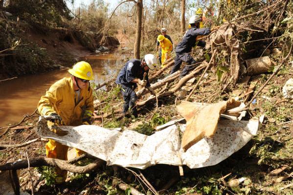 rescuers remove debris