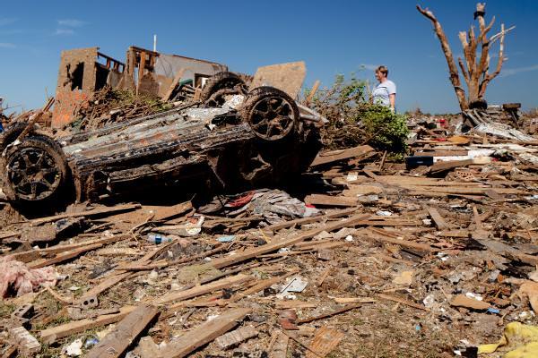 tornado debris damaged car